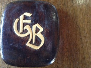 The back of the cigarette box carved by Brosig with his initials