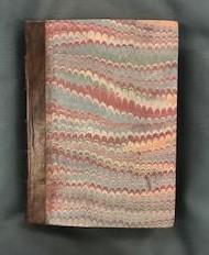 Front cover of book recovered in marble paper. The measurements of the book are 191(l)x138(w)x127(d)mm which indicates that it would have been an easily portable book.