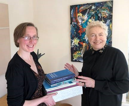 Beth and Dame Stephanie passing on the first items from the Shirley Foundation Collection