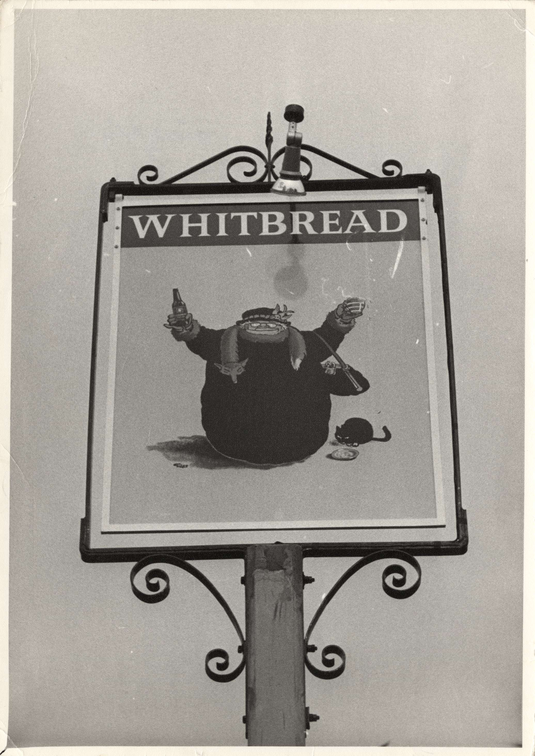 Black and white photo of the sign for 'The Giles' pub, which includes a picture of Grandma and Natalie the cat - 30 October 1973 (Image ref: GAPH00069)