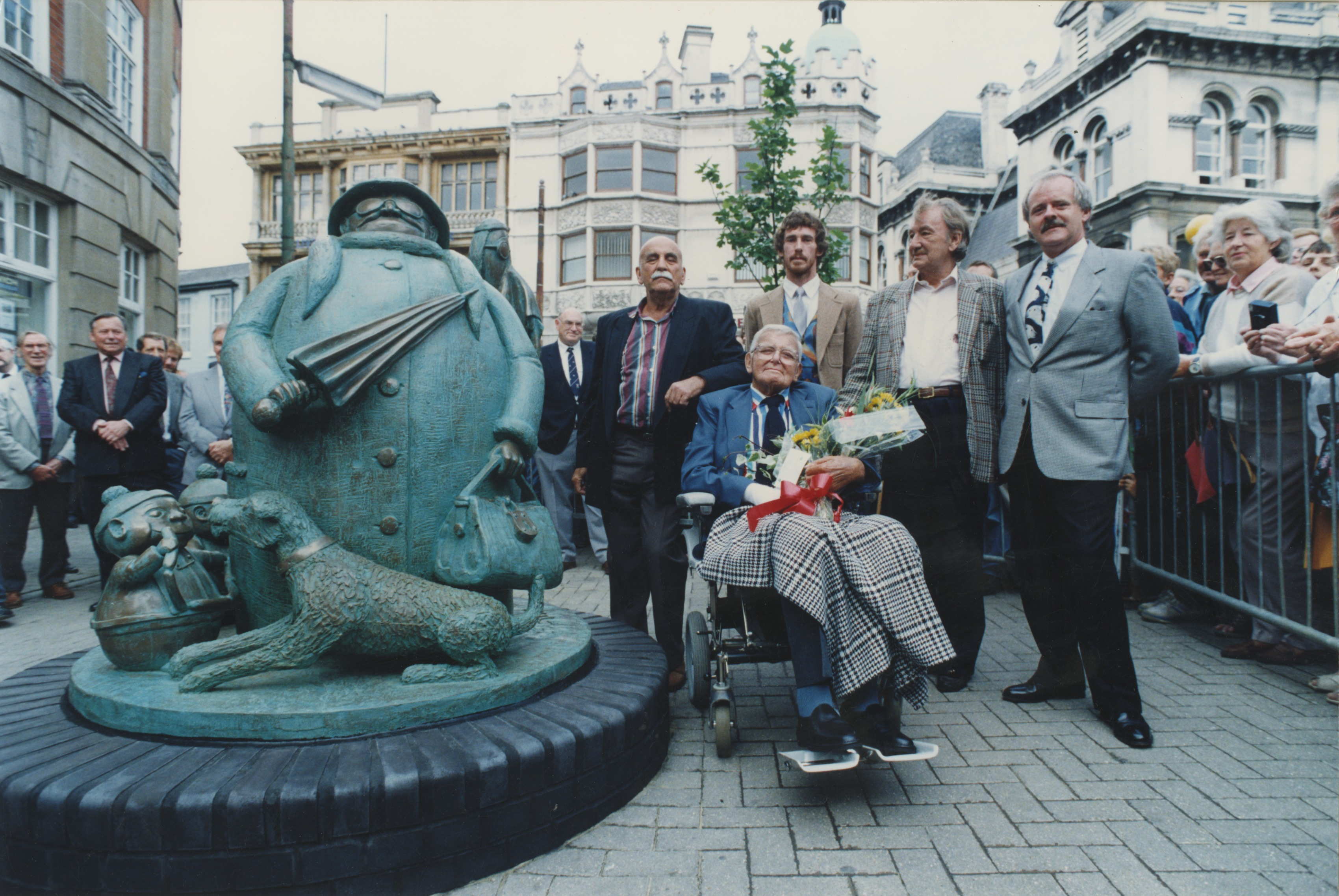 Colour photo of the unveiling of the Grandma statue in Ipswich, featuring actor Warren Mitchell , Giles, the sculptor Miles Robinson, writer and friend Johnny Speight, and Andrew Cameron (Express Newspapers) - September 1993 (Image ref: GAPH00430)