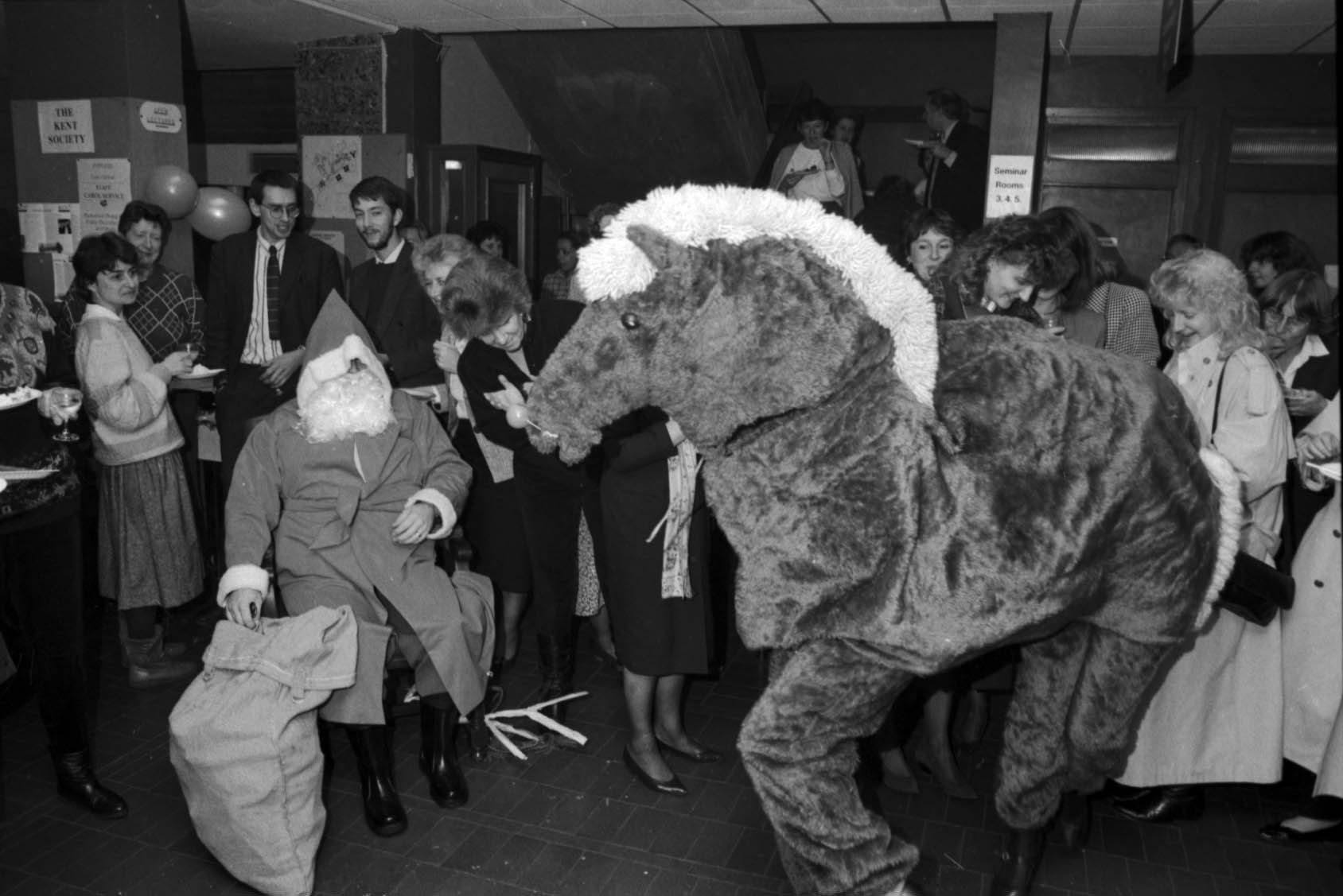 Black and white photograph showing a party in the Registry Office, 1990, complete with Santa and a pantomime horse. [University of Kent Archive, 1471.2]