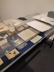 Display case with elements from the Diaries of the Here and Now exhibition