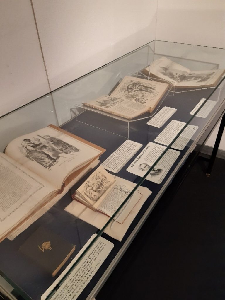 Display case with elements of the Politics in Wonderland: Sir John Tenniel at 200 exhibition