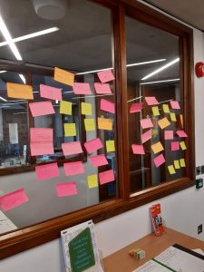 Coloured post-it notes on window in Special Collections reading room from War of the Roses: text and adaptation seminar