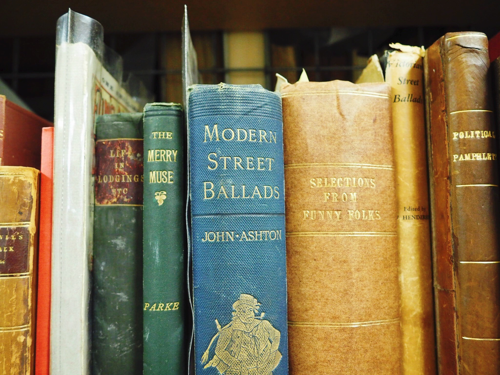 A colourful row of books from the John Crow Ballad and Song collection.