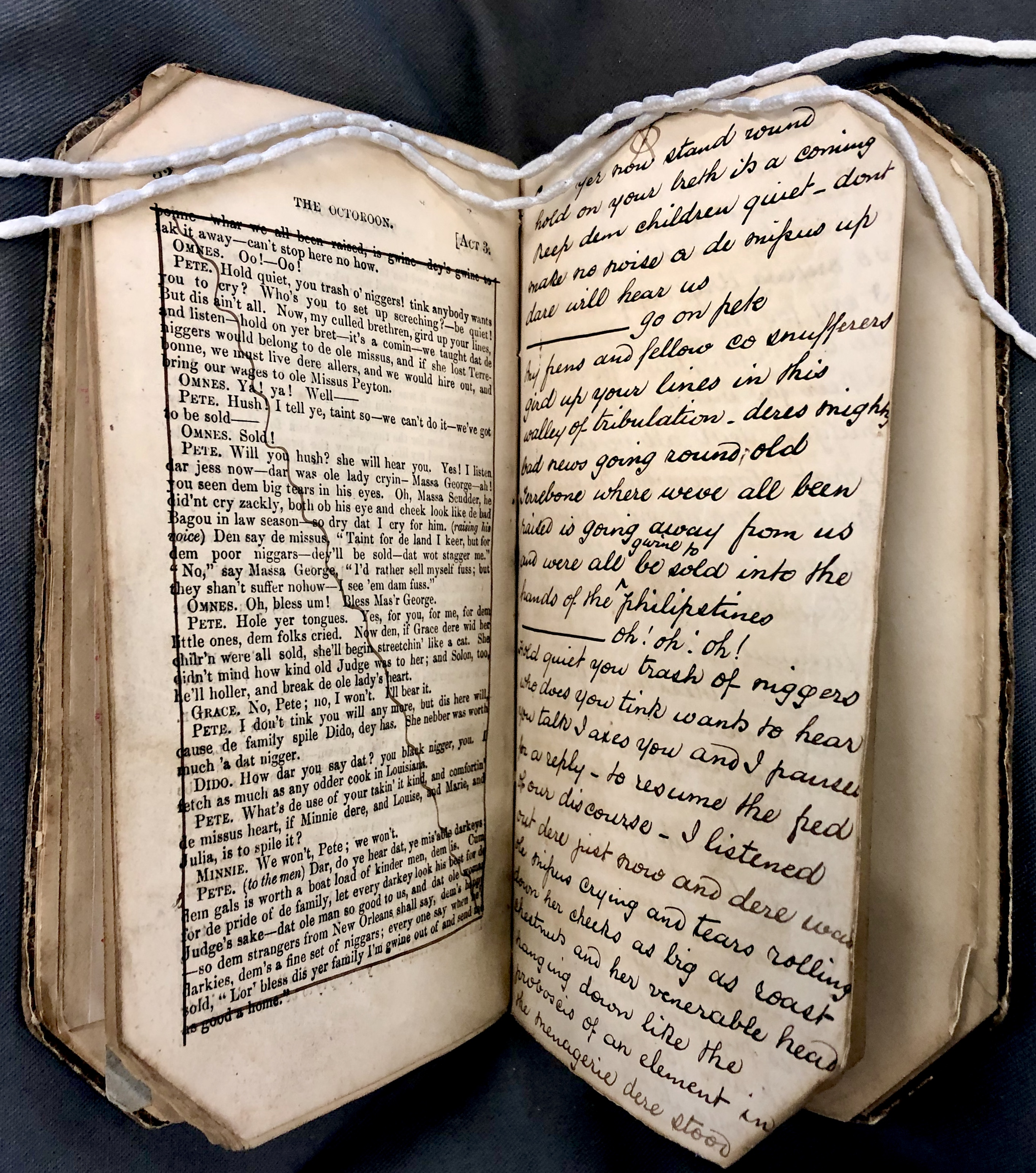 Photograph of the play text for Boucicault's play 'The Octoroon', from the Pettingell collection. The printed text is crossed out and handwritten revisions are included on the next page.