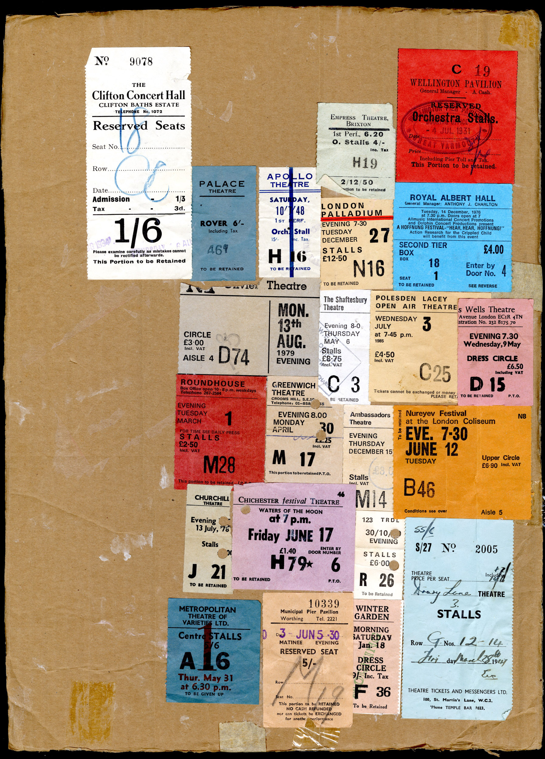 Selection of tickets from music hall events pasted on to a brown backing board from the Max Tyler Music Hall Collection