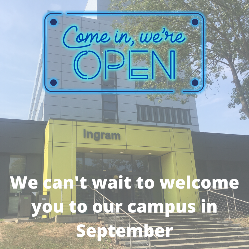 We are Open Sign in front of Ingram Building at the University of Kent