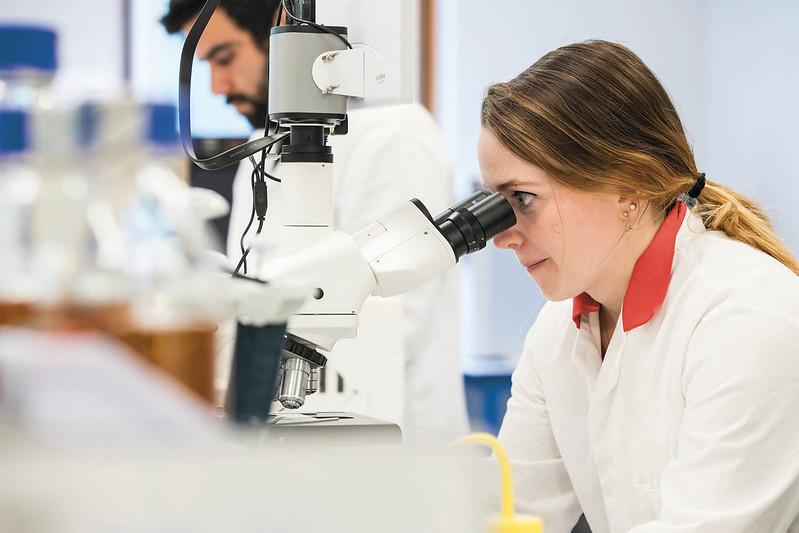Postgraduate student using equipment in a science laboratory