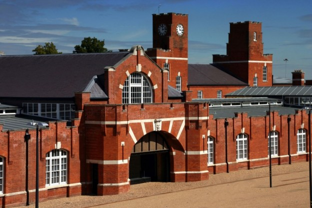 An image of Drill Hall Library with red brick and an arched frontway