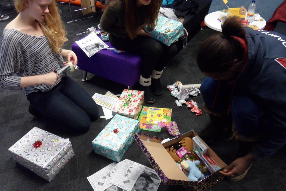Image of students filling boxes