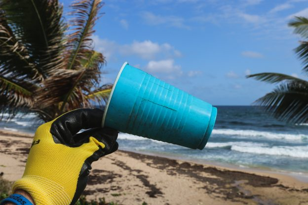 Plastic cup on a beach