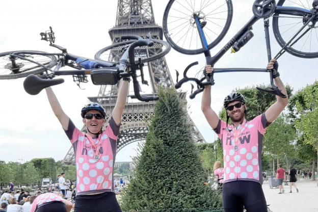 Garrett Gorman and Rich Payne with their bikes in front of the Eiffel Tower