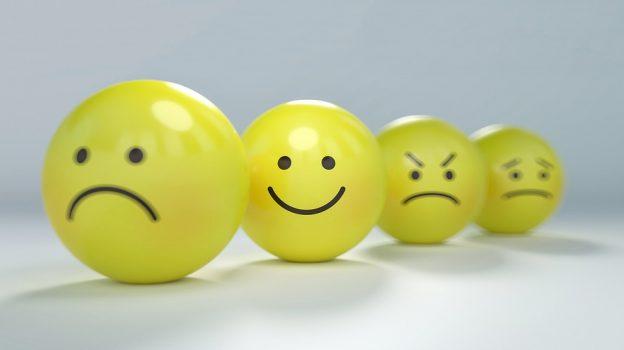 Four yellow smiley faces