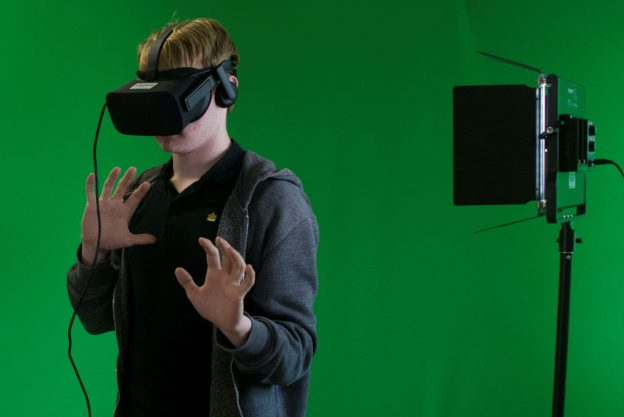 Person wearing VR headset in green room