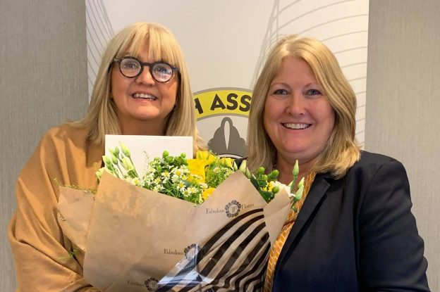Jacqui and Debbie presenting flowers