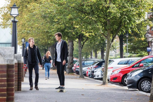 two male students walking on Medway campus