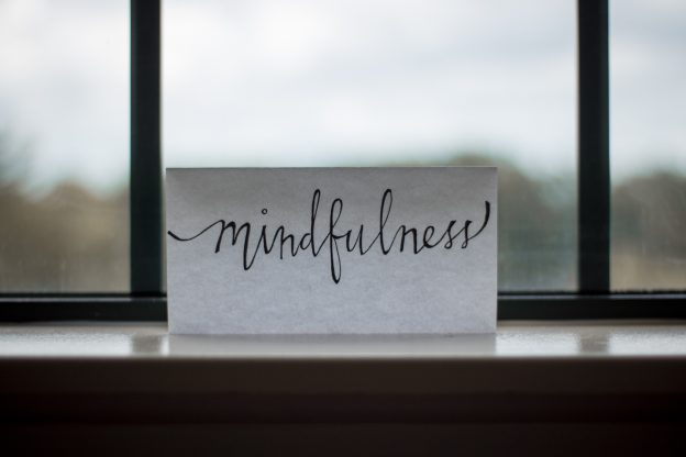 Window with paper that has mindfullness written on it