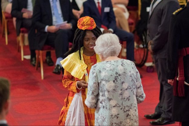 Founder of Dominica Dementia Foundation Rianna Patterson meets the Queen as she collects her award of the Queens Young Leader in 2017