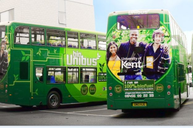 Two green Unibuses lined up together