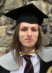 Angus Nisbet in graduation gown and cap