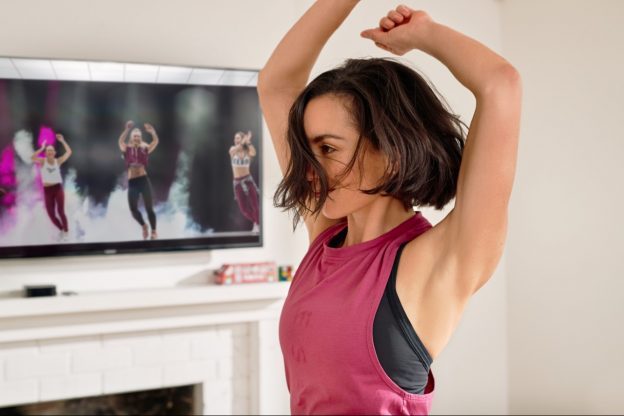 Woman doing exercise with her arms in the air