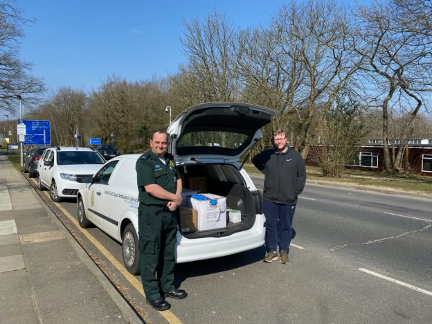 Kent staff and ambulance paramedic loading personal protective equipment into car