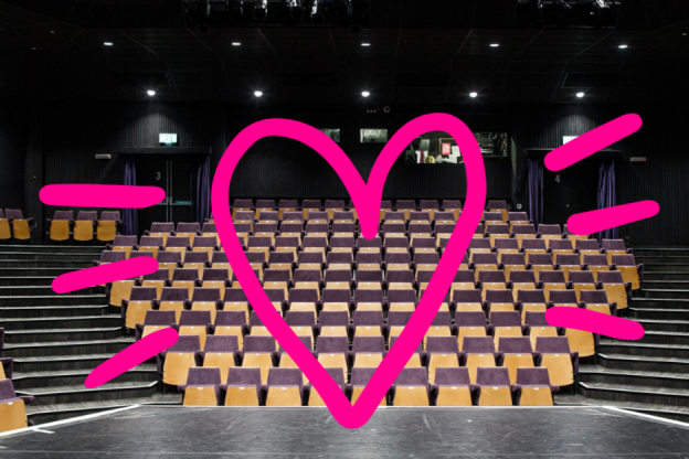 Empty Gulbenkian theatre with a pink heart designed in front of the image