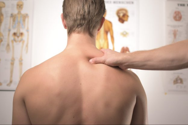 A man's having physiotherapy on his back