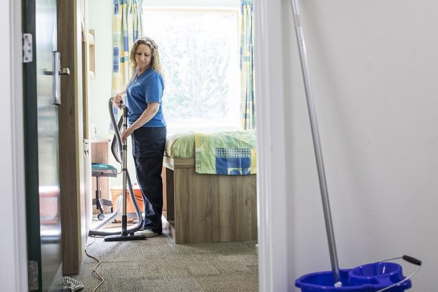 A member of the Housekeeping team working