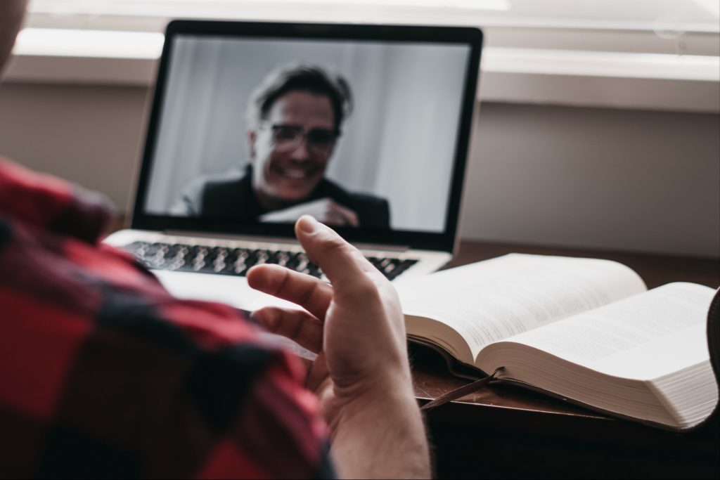 Person on a video chat via a laptop