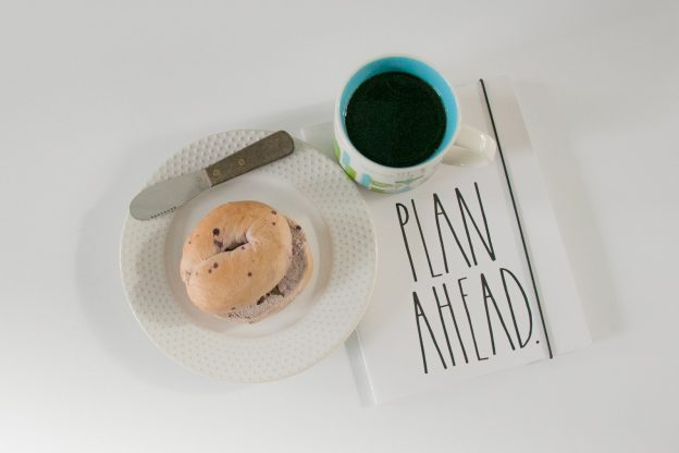 Plan ahead notebook, coffee and bagel