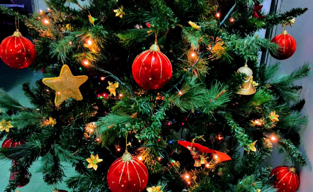 Christmas tree with red baubles and gold stars