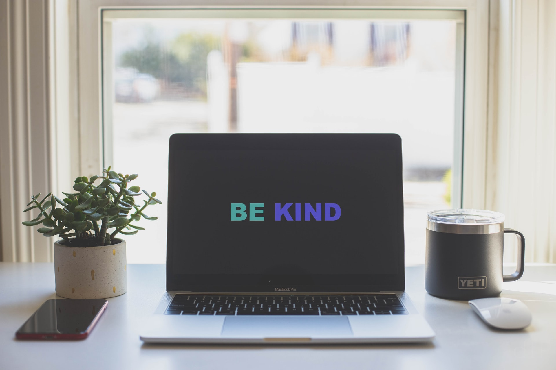 Be kind message on laptop screen