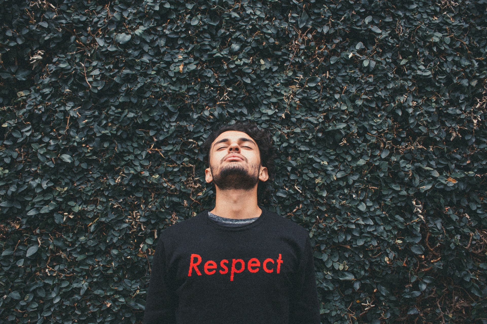 "Man wearing jumper that says ""respect"""