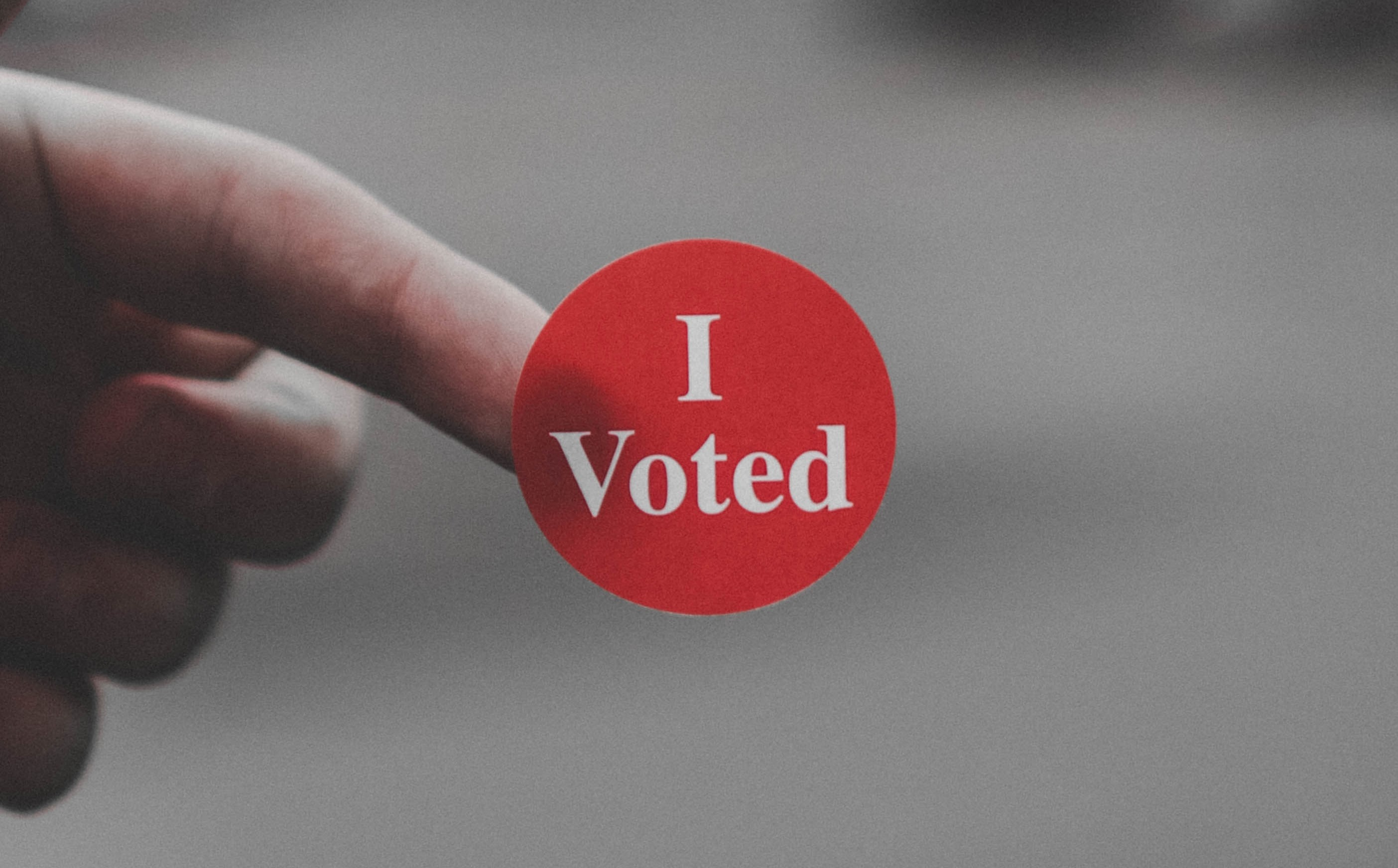 red sticker with the text 'I voted'