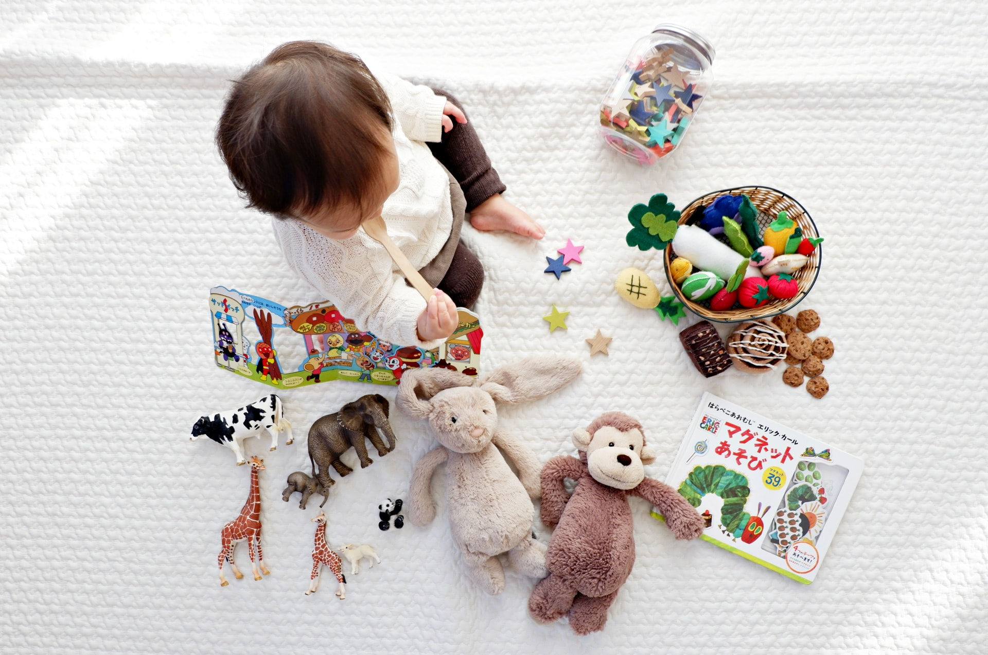 Child sitting on floor playing with toys