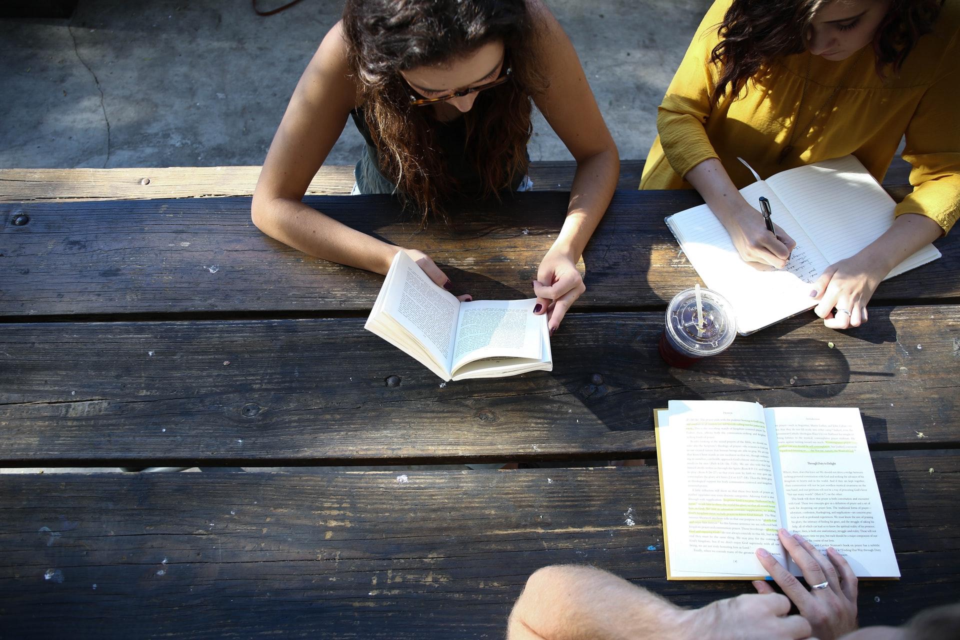 Students studying at picnic bench