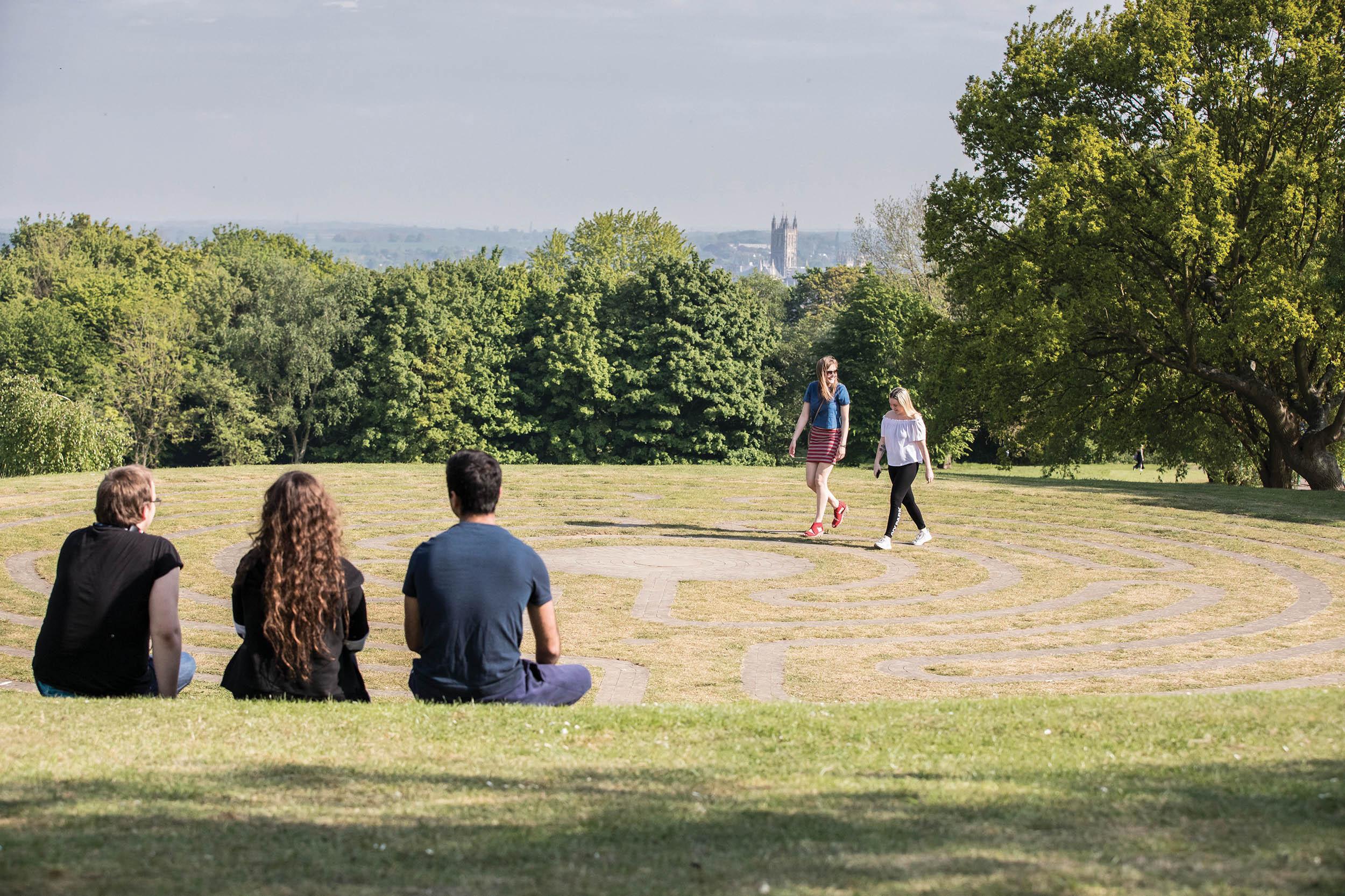 Students sat at labyrinth at the Canterbury campus