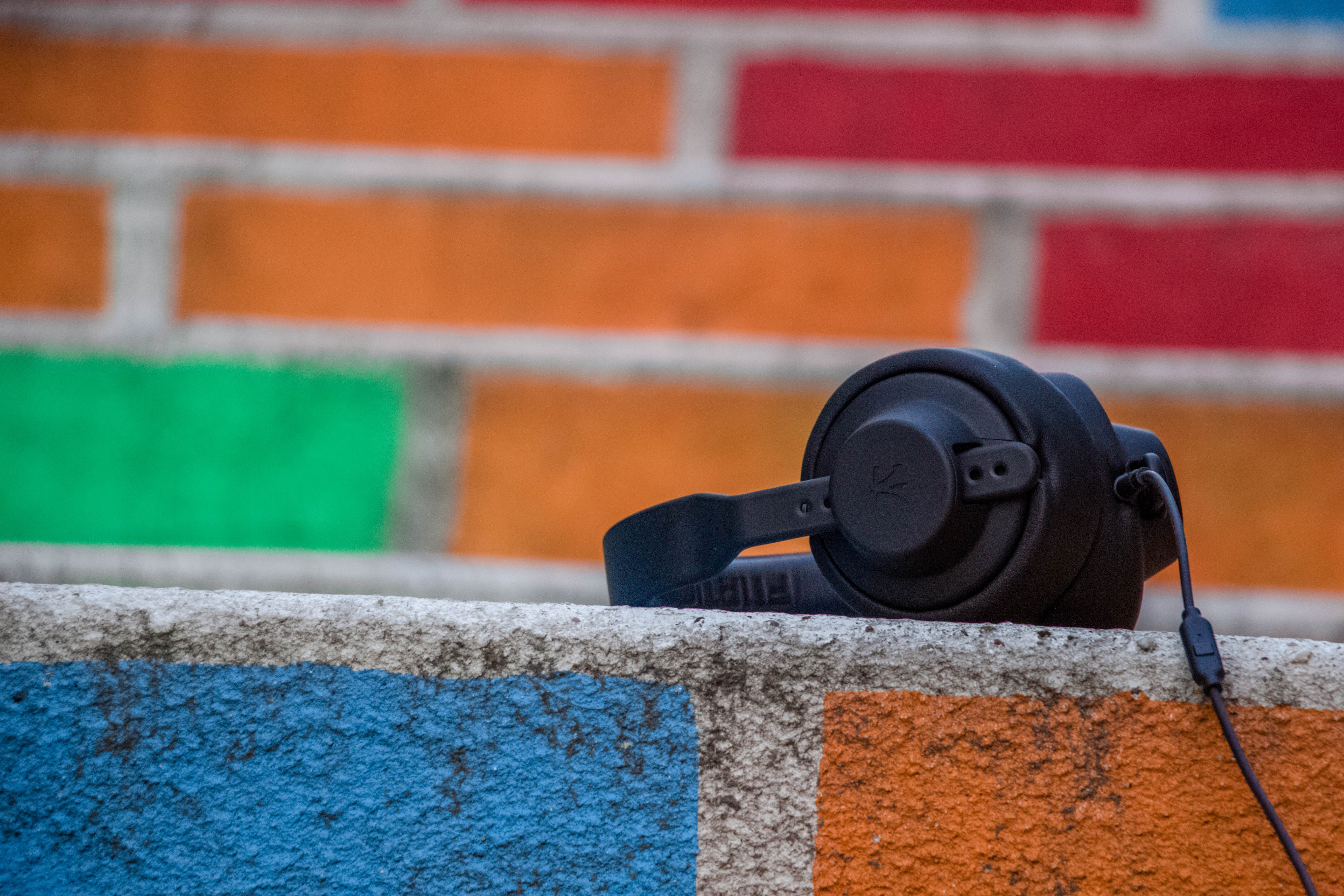 Headphones on a colourful painted wall