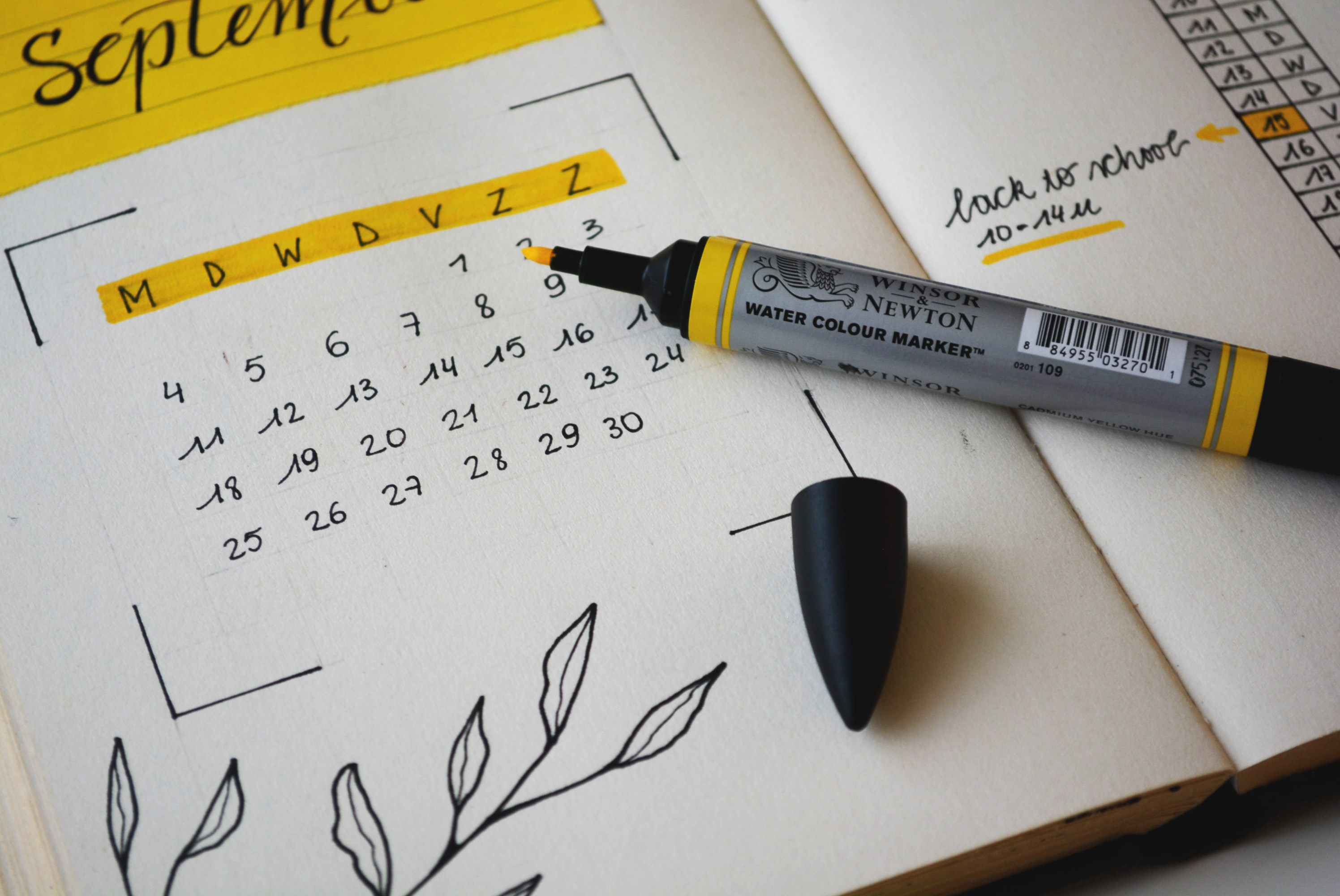 journal with September calendar written out and highlighted in yellow