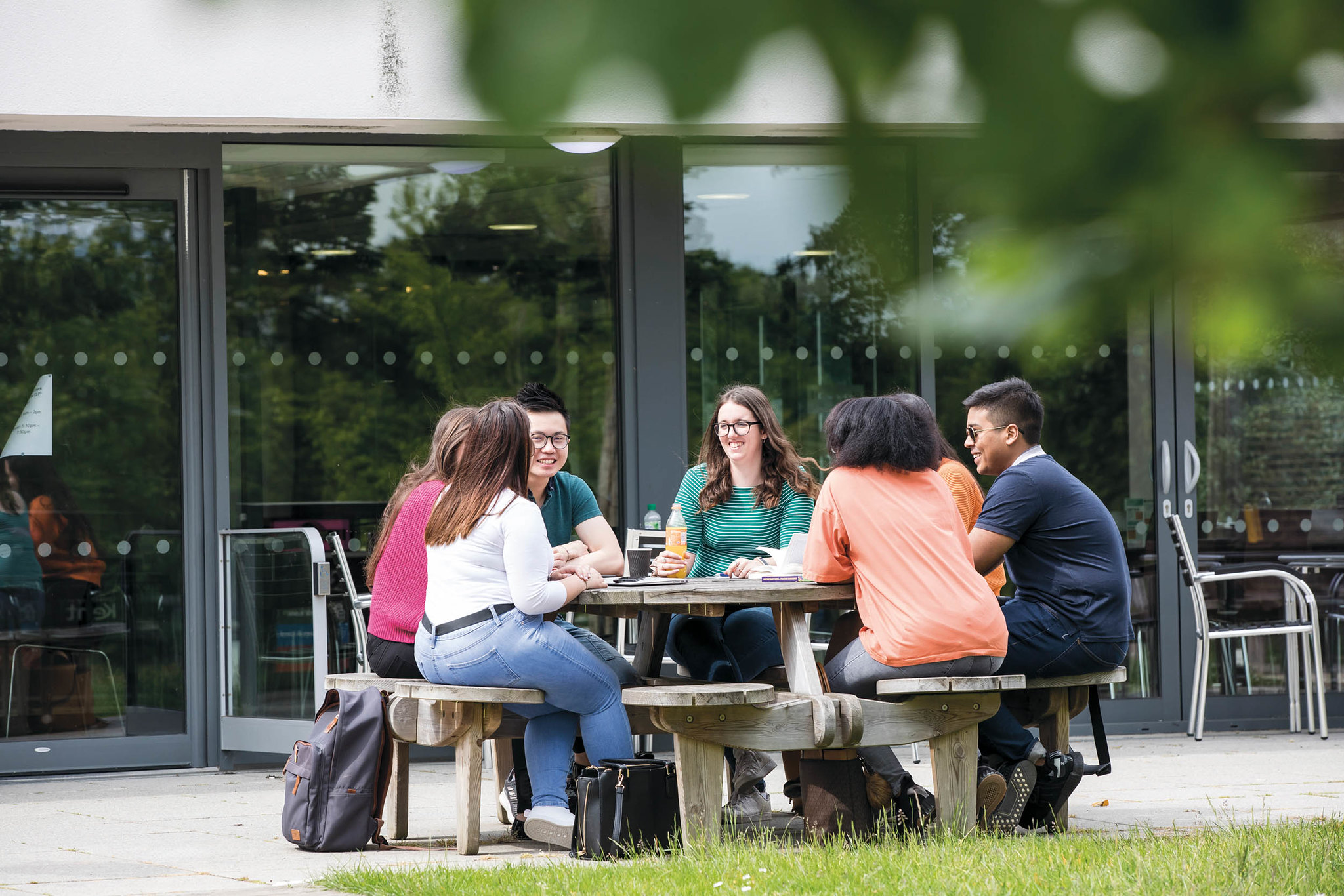Students sat at bench