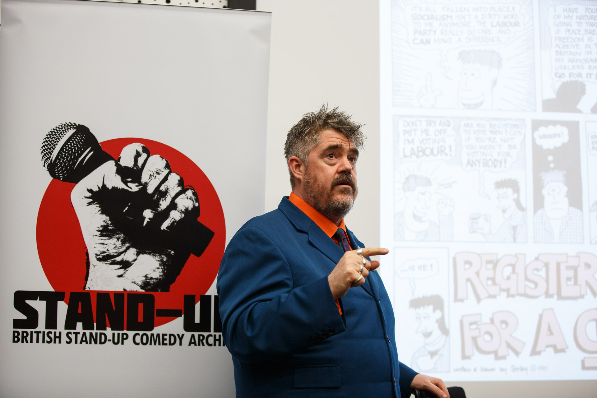 Phill Jupitus talking about a Red Wedge Comedy leaflet which cartooned for (as Porky the Poet). Photo Matt Wilson