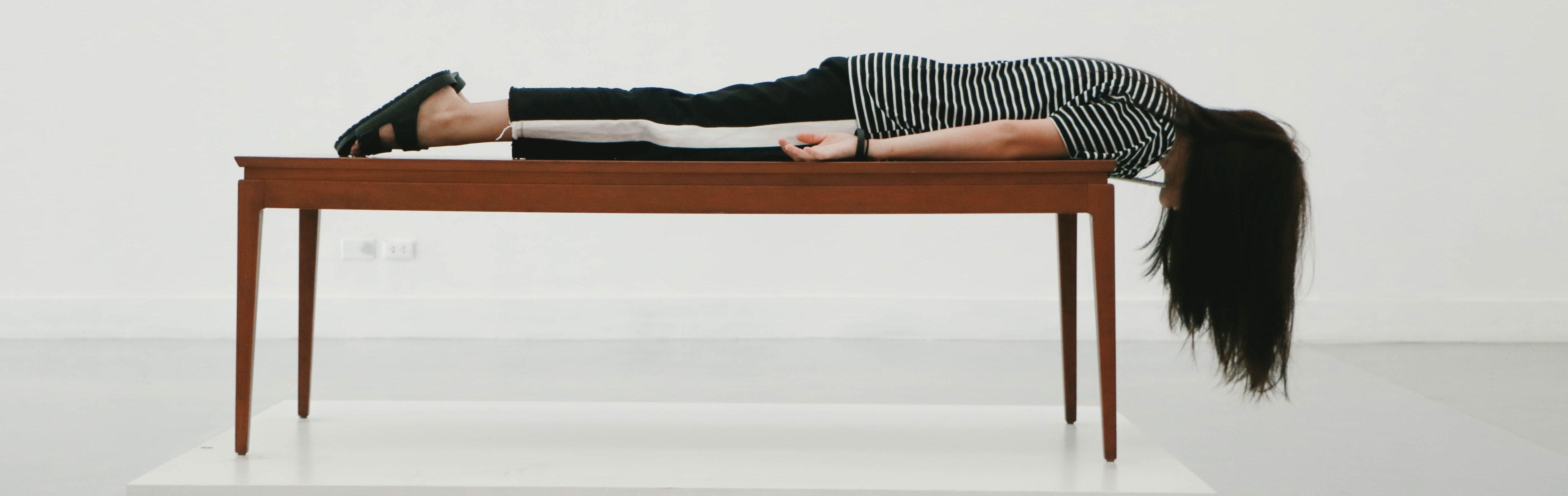 Woman lying on desk