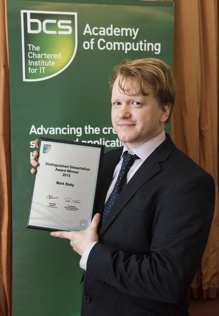 Mark Batty holds dissertation award certificate