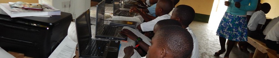 Pupils in Ugandan classroom at computers