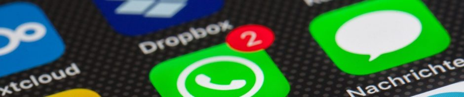 close up of WhatsApp logo on screen