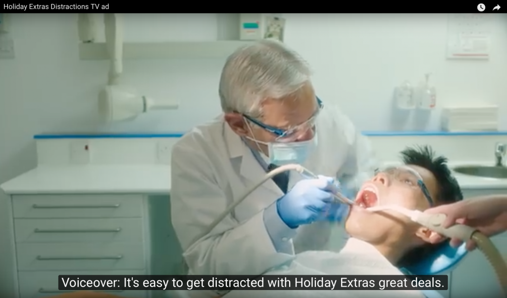 screenshot of advert with student posing as dental patient