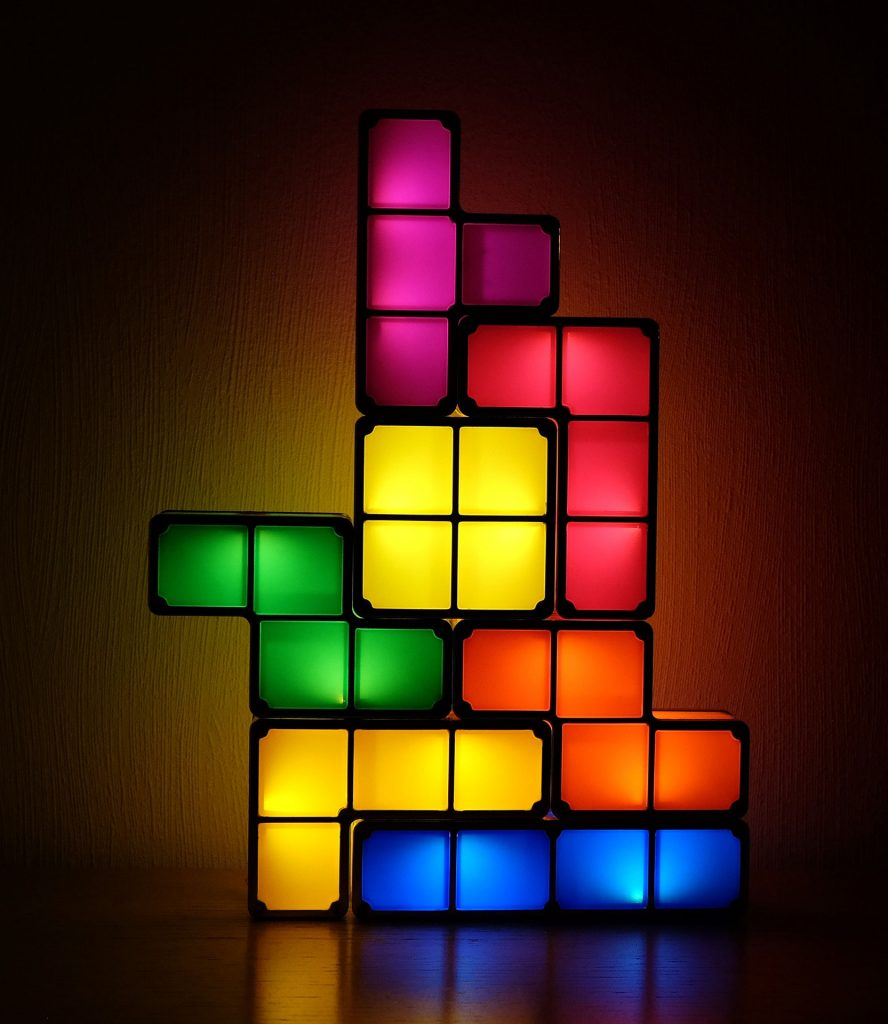 Tetris lights in bright colours on dark background